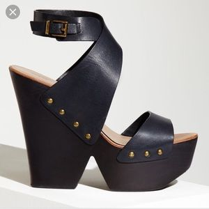BCBG Jenessa black leather wedge with stud accents